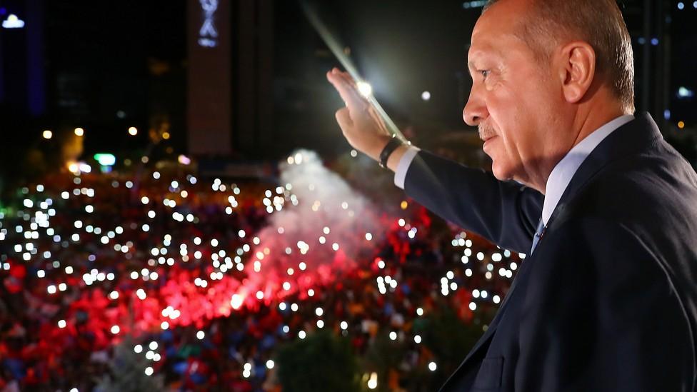 President Erdoğan waves to supporters far below