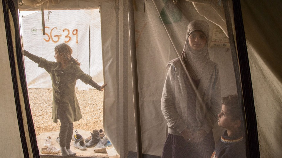 Syrian children inside a camp tent
