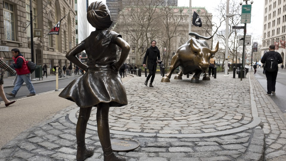 """The """"Fearless Girl"""" statue faces down Wall Street's famous Charging Bull."""