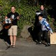 "Yee Feng sings ""Keep Your Head Up"" by Andy Grammer with wife, Carolyn, and kids Ellie, 9, and Jediah, 11, during a neighborhood sing-along they have started doing each evening to connect with neighbors while social distancing during the coronavirus outbreak in Seattle."