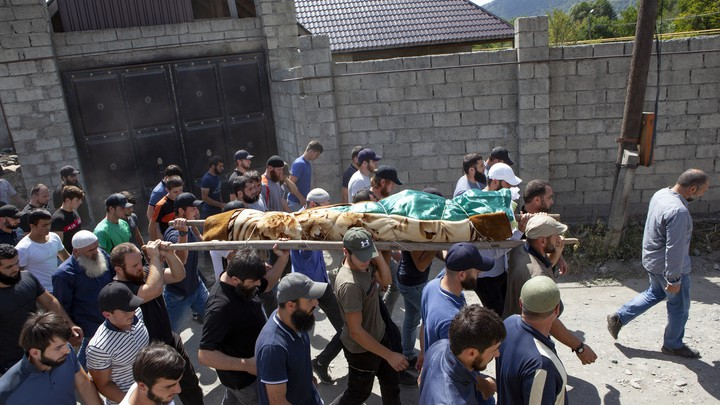 Mourners carry the body of a Chechen dissident in Duisi village, the Pankisi Gorge valley, in Georgia.