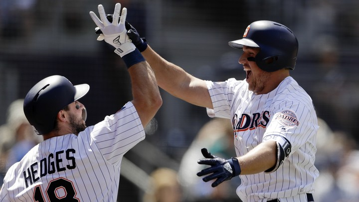 The San Diego Padres' Hunter Renfroe (right) celebrates with his teammate Austin Hedges.