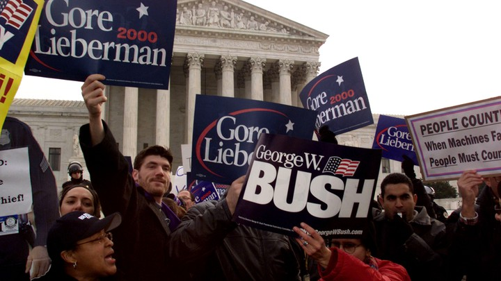 George W. Bush and Al Gore supporters hold signs outside the U.S. Supreme Court.