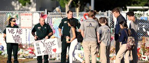 Police show their support at Marjory Stoneman Douglas High School in Parkland, Florida.