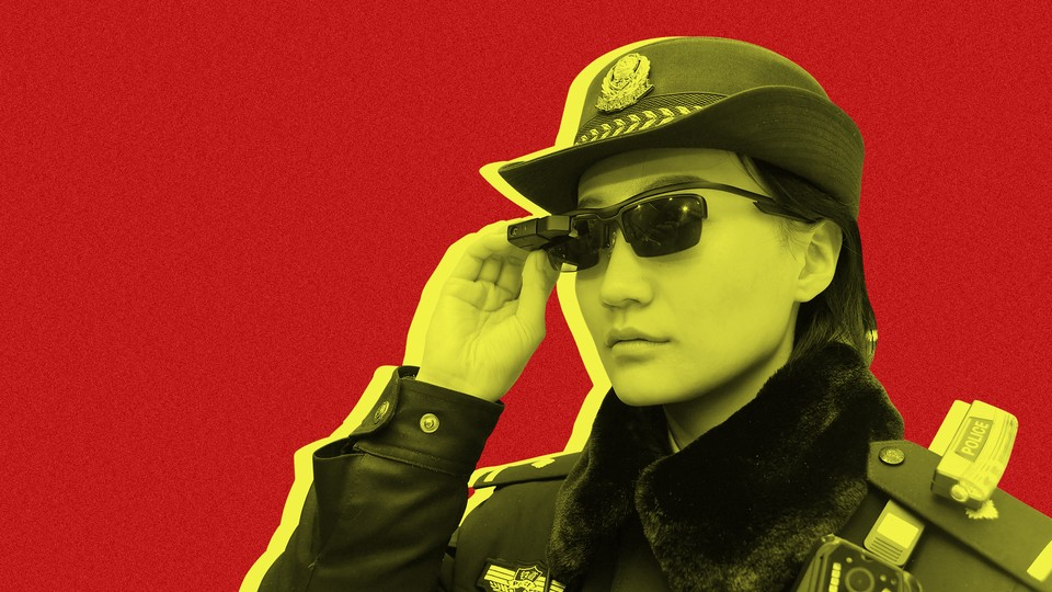 """A police officer wearing a pair of """"smart glasses"""" with a facial-recognition system at Zhengzhou East Railway Station in China"""