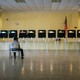 An election official sits in a chair while waiting for voters to arrive at a polling station in Miami, Florida, U.S., on Tuesday, March 17, 2020. Voters in Florida, Illinois and Arizona were trickling into the polls Tuesday as the coronavirus pandemic continued to wreak havoc on the Democratic presidentialprimarycalendar with Ohio postponing its contest, citing a public health emergency.