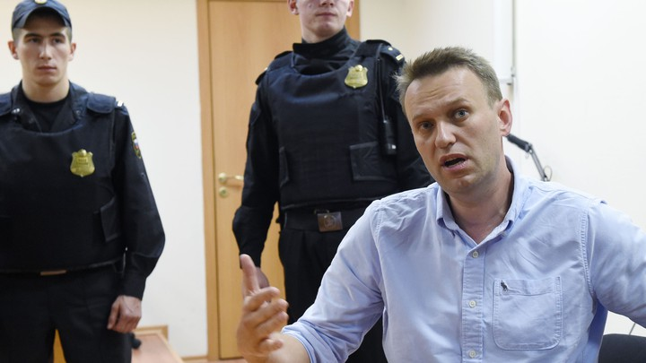 Russian opposition leader Alexei Navalny speaks after a hearing in a court in Moscow, late on June 12, 2017.