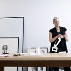 Artist Molly Spain works in her fourth floor studio at Mainframe.