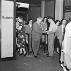 A 1948 photo of people getting transfers at the New York City subway.