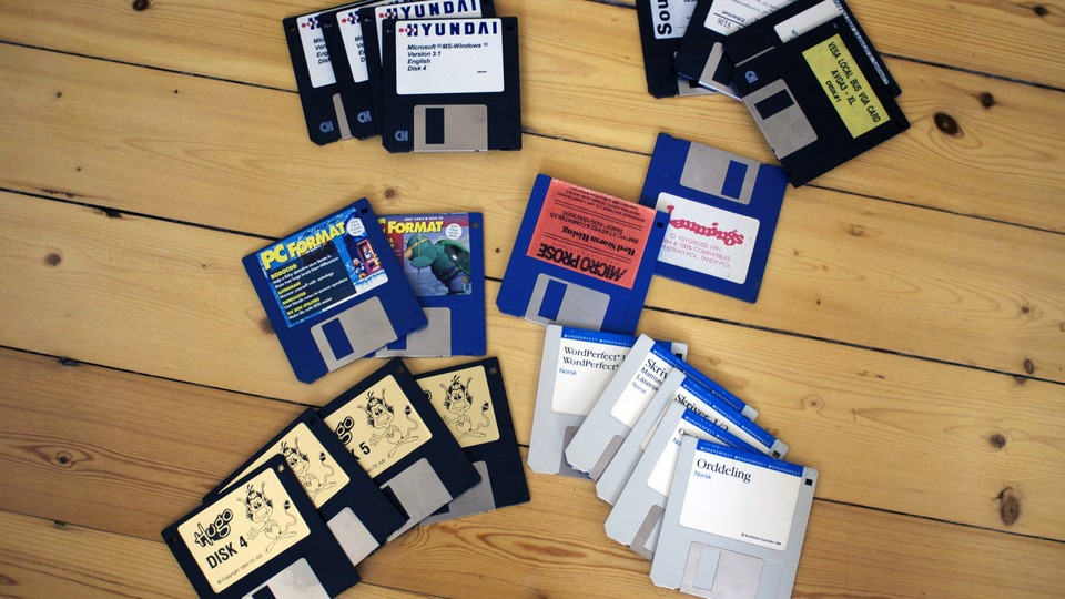 Floppy disks arranged on a wood floor