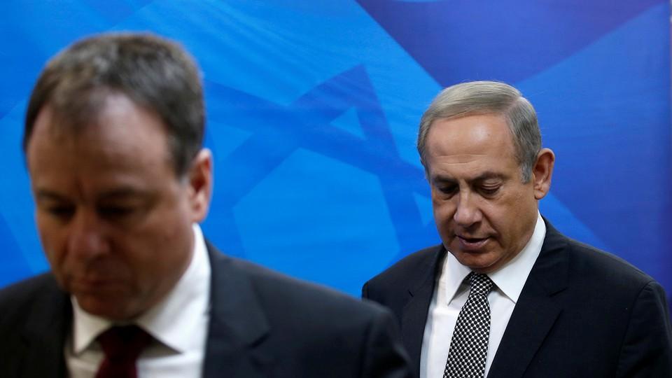Israeli Prime Minister Benjamin Netanyahu arrives at the weekly cabinet meeting in Jerusalem on January 15, 2017.
