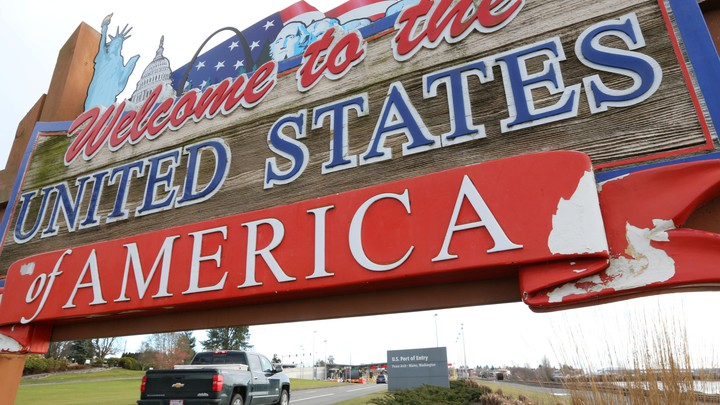 "A sign stating, ""Welcome to the United States of America"""