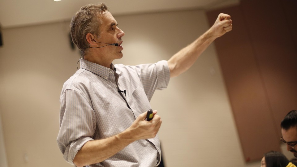 Jordan Peterson lecturing with a microphone.