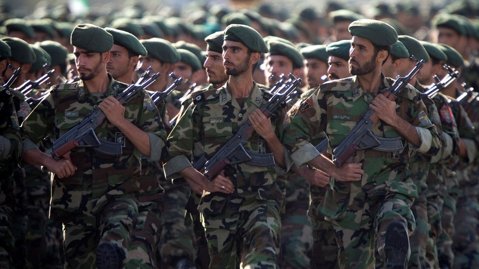 Soldiers in fatigues marching in formation