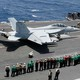 Sailors on the USS Abraham Lincoln take part in an aerial change of command ceremony in the Arabian Sea.