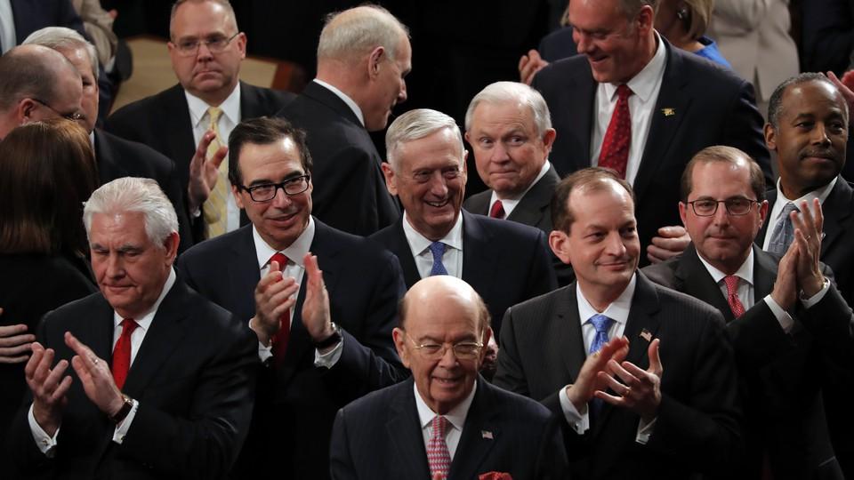 Cabinet members applauding