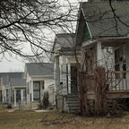 photo: a mix of vacant and inhabited homes in Detroit.
