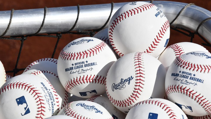 Warm-up baseballs on the field before the game between the Washington Nationals and the New York Mets at Nationals Park on March 28, 2019