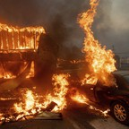 Flames engulf a house and car in Paradise, California.