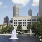 A fountain surrounded by downtown buildings