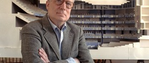 The architect Robert Venturi in 1991, with a model of a new hall for the Philadelphia Orchestra in the background.