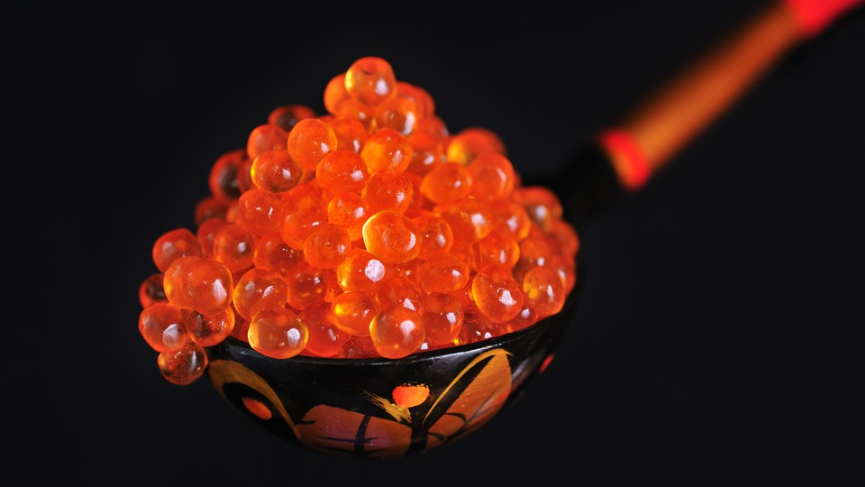 A spoonful of red caviar