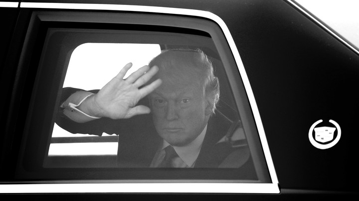 Trump waving from a car