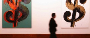 """Andy Warhol's """"Dollar Sign"""" paintings are pictured."""
