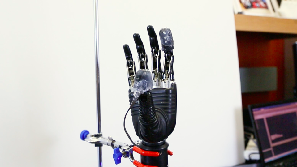 Prosthetic hand made of black plastic