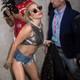 Lady Gaga poses for paparazzi.