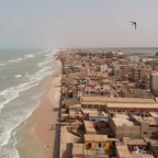 An aerial view of where Saint-Louis, Senegal, meets the Atlantic Ocean.
