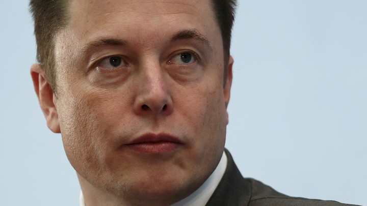 A close up of Elon Musk's face