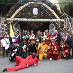 A traditional band of performers poses for a photo during the celebration of Santiago Apostol in Iztapalapa.