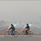 A photograph of bicycles in China that are equipped with air filtration equipment to protect riders from smog.