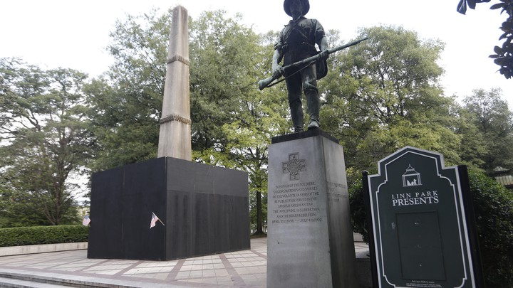 A plywood partition surrounds a Confederate monument in Birmingham, Alabama's Linn Park.