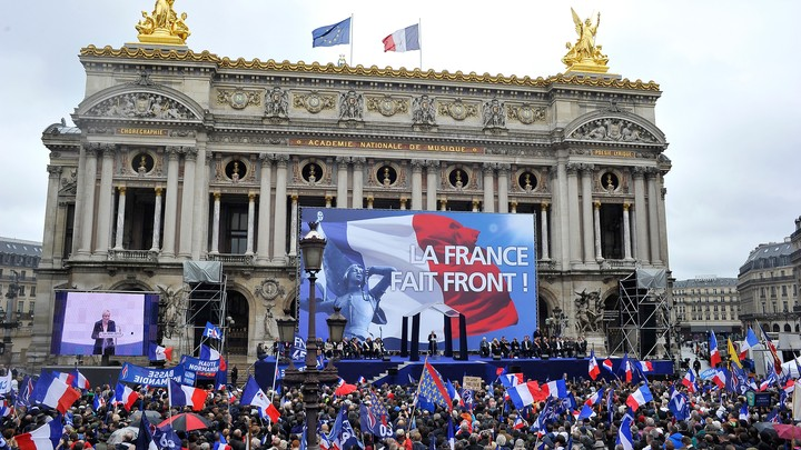 Marine Le Pen delivers a speech on stage during the National Front annual rally honoring Joan of Arc on Place de l'Opera, on May 1, 2015 in Paris, France.