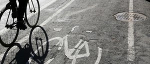 A photo of a bicycle in a bike lane.