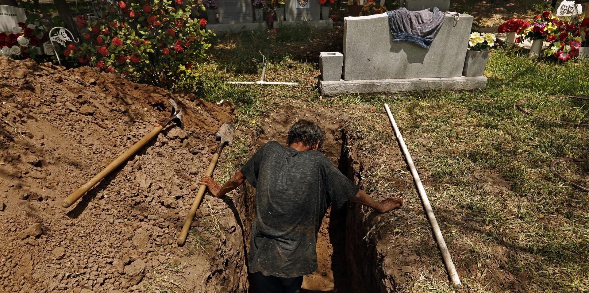 Jesus Torres digs graves at La Piedad Cemetery in McAllen, Texas.