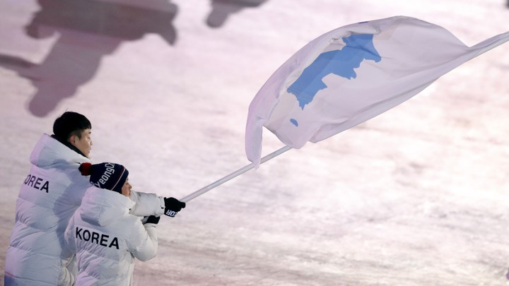 Hwang Chung Gum and Won Yunjong carry the flag during the Pyeongchang Winter Olympics opening ceremony.