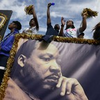 People stand by a banner of Martin Luther King.