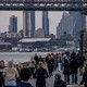 People run through crowds on the East River during the Coronavirus outbreak in New York City.