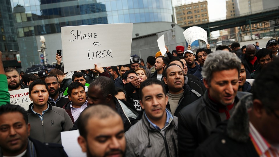 Uber drivers protesting in New York in 2016