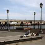A photo of a man sleeping on San Francisco's Embarcadero