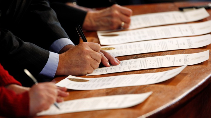 North Carolina Electoral College representatives sign the Certificates of Vote after they all cast their ballots for U.S. President-elect Donald Trump in the State Capitol building in Raleigh, North Carolina, U.S., December 19, 2016.