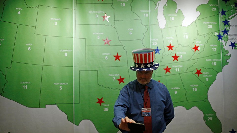 A man takes a selfie in front of the Electoral College map during a U.S. Election Watch event hosted by the U.S. Embassy at a hotel in Seoul, South Korea, November 9, 2016.
