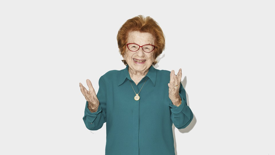 A photo of Dr. Ruth holding out her hands and smiling