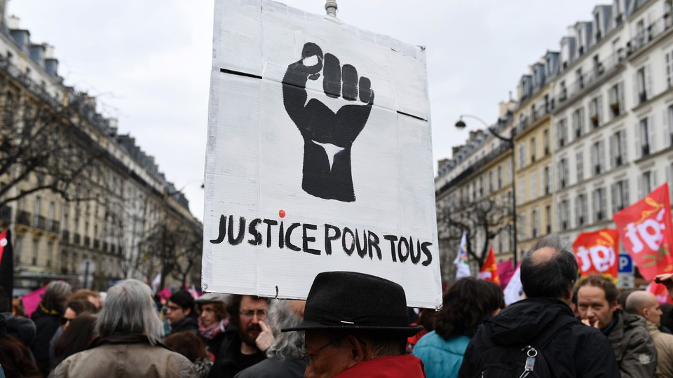 Protesters attend a demonstration against police brutality and racism in Paris in 2017.