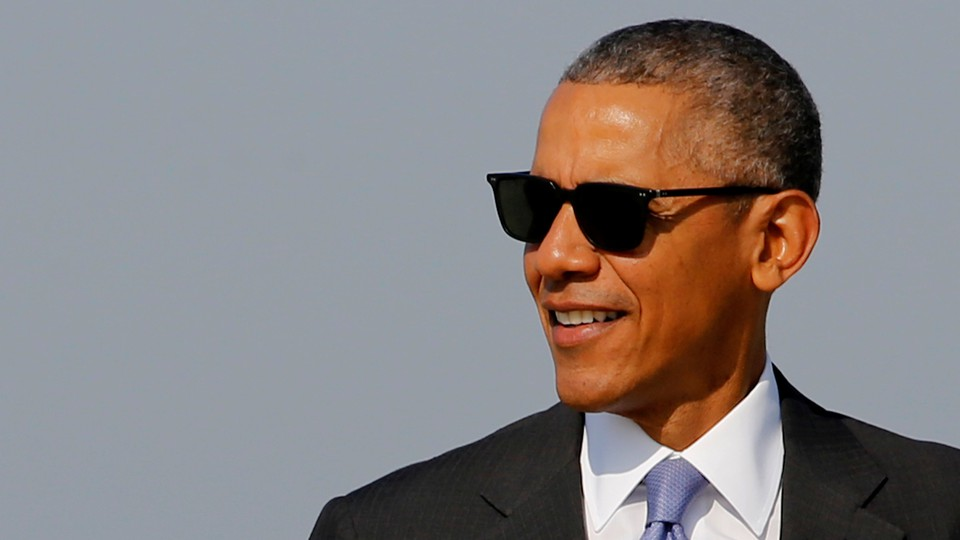 Barack Obama wearing a suit and sunglasses