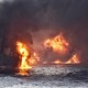 An oil tanker engulfed in flame