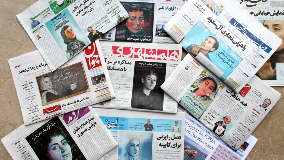 A picture taken in Tehran shows the front pages of Iranian newspapers bearing portraits of Maryam Mirzakhani.